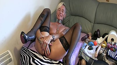 GRANDMA GILF DOES A HUGE BUTTPLUG IN..