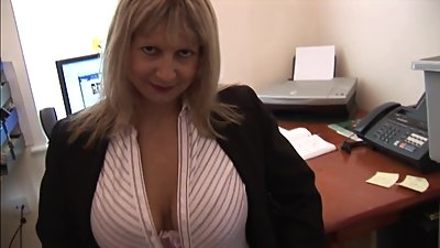 Busty blonde secretary in stockings..