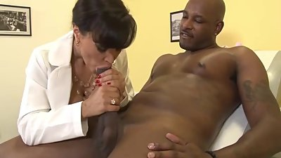 Doc with big tits suck BBC