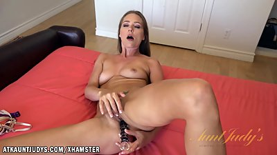 Star slides her glass dildo into her..