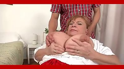 Granny with huge tits fucks young boy...