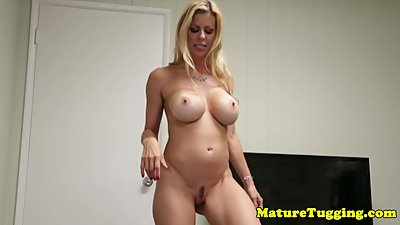 Bigtitted milf tugging hard cock pov