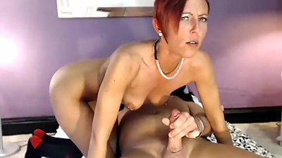 Mature beauty tittyfucking on her knees