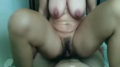 Hairy mature with big tits and trimmed..