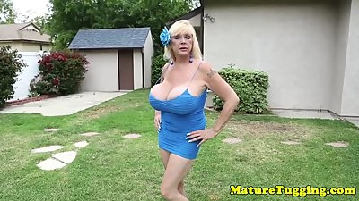 Hugetitted cougar tugging and..