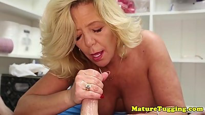 Busty stepmom jerking and titfucking..