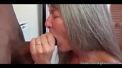 Grey haired honey gets fucked by black..